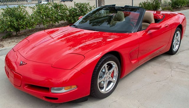 2002 red corvette convertible coming